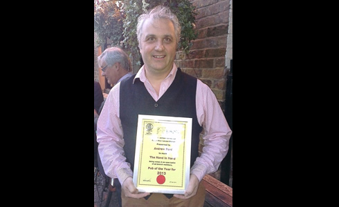 Licensee Andrew Ford with the Pub of the Year 2013 certificate.